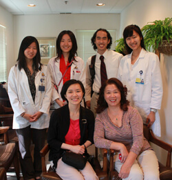 Advanced medical Mandarin students (back row) with their instructor, Hsing-Chen Tsai (front left), and Mei Du (front right), an employee at the Chinese-speaking clinic in Ellicott City.