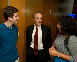 Roy Ziegelstein, vice dean for education, socializes with students at the first of a series of new seminars.