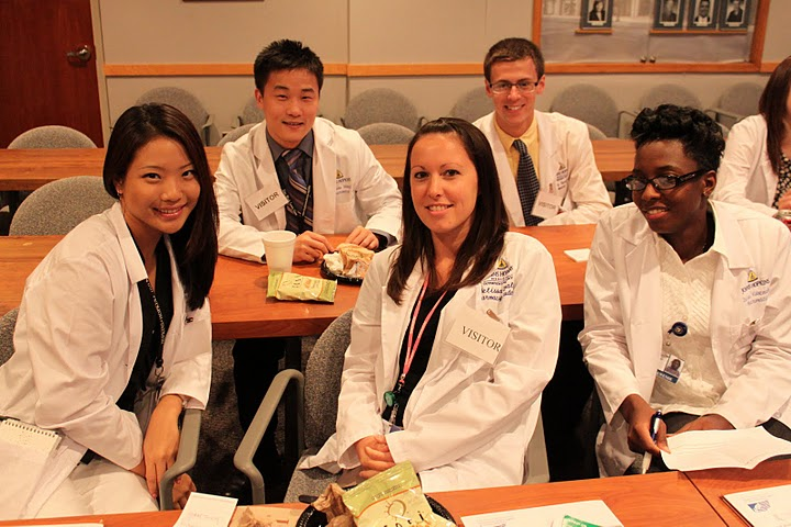 group of interns in lab coats