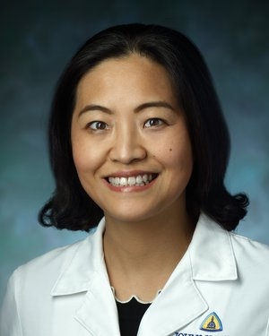 Photo of Dr. Huimin Yu, B.M., M.D., Ph.D.