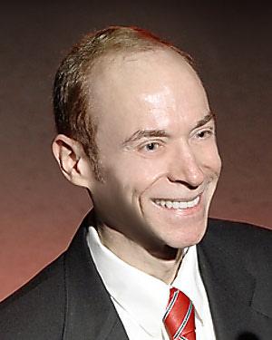 Photo of Dr. Jim Brasic, A.M., M.A., M.D., M.P.H., M.S.