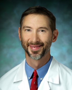 Photo of Dr. John Edgar Tis, M.D.