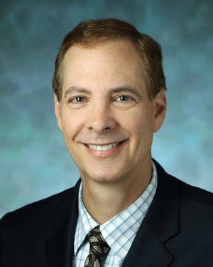 Headshot of Alan J Kronthal