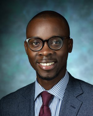 Headshot of Julius Kunle Oni