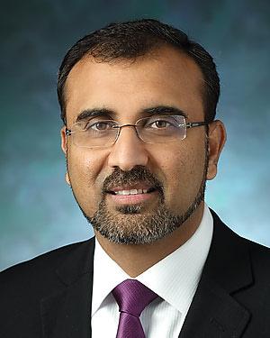 Headshot of Malik Muhammad Adil