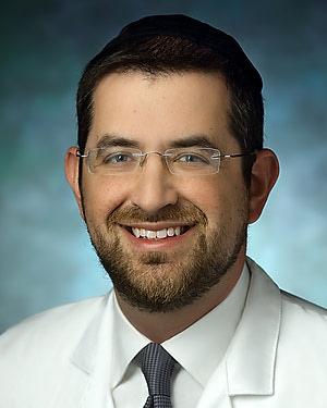 Headshot of Daniel Raphael Aaron Sova