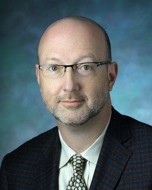 Headshot of James J. Pekar