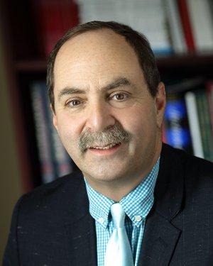 Headshot of Paul Barton Rosenberg