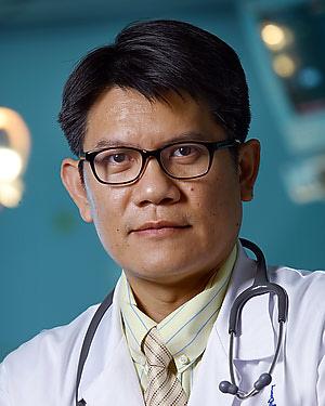Headshot of Wikrom Wongwanich Karnsakul