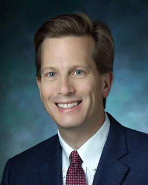 Headshot of Andrew J. Ewald