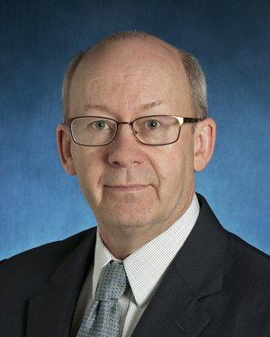 Headshot of Peter C Rowe