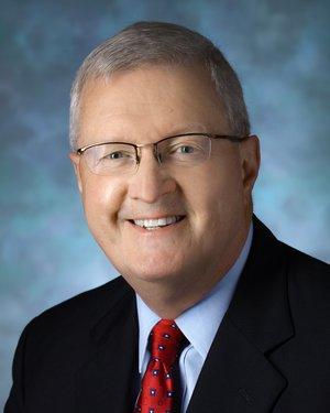 Headshot of John P Gearhart