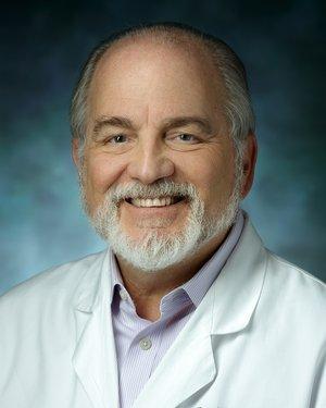 Headshot of Peter Wolfe Kaplan