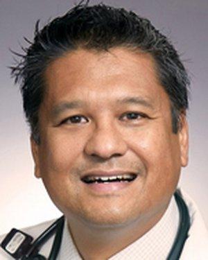 Headshot of Michael E Carlos