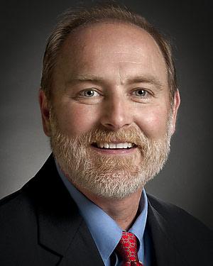 Headshot of Norman J. Barker