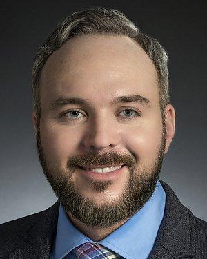 Headshot of Christopher James VandenBussche