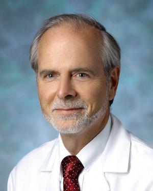 Headshot of Christopher J Earley