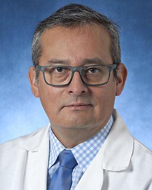 Headshot of Juan R Carhuapoma