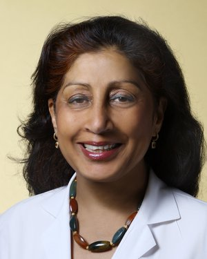 Headshot of Nisha Chandra-Strobos