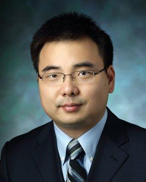 Headshot of Chen Hu