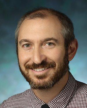 Headshot of Hal Benjamin Kronsberg