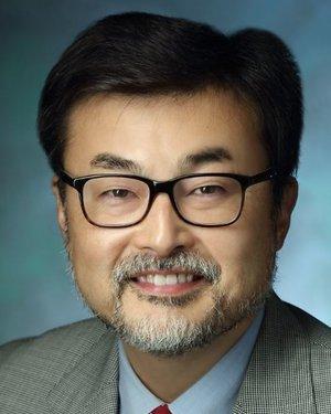 Headshot of Katsuyuki Taguchi