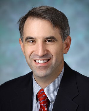 Headshot of Eric Kossoff