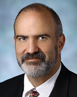 Headshot of Darius Anthony Rastegar