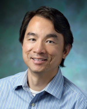 Headshot of Guang William Wong