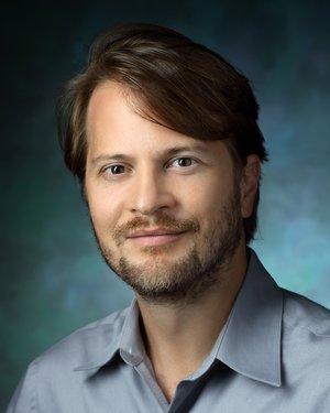 Headshot of Marshall G. Hussain Shuler