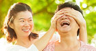 Two Asian women laughing