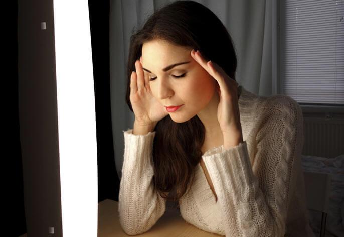 Woman using a light box