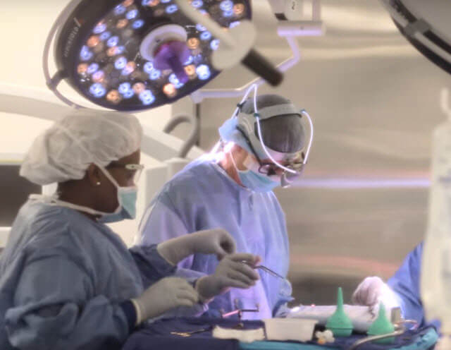 Doctors performing surgery to remove a brain tumor