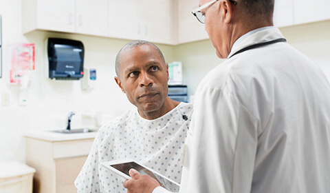 Man speaks with his doctor.