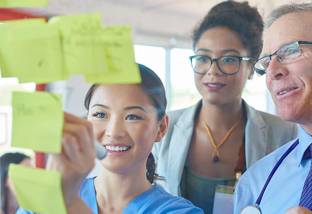 doctors look at post-its in a workshop activity