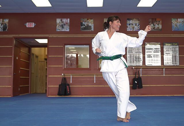 Michelle practices tae kwon do