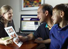Dr. Margaret Skinner, pediatric ENT at Johns Hopkins, talks with a father and son.