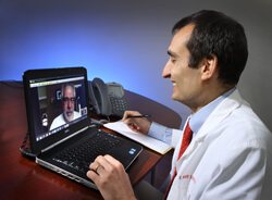 Neurologist Ray Dorsey says telehealth consultations often help patients feel more comfortable discussing their health from home.
