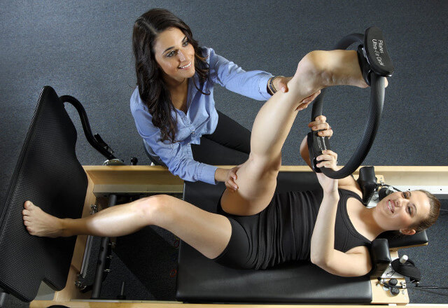 A physical therapist working with a gymnast