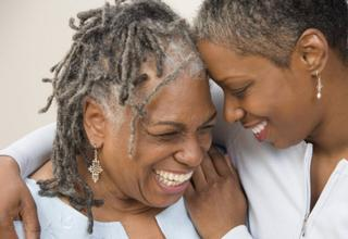 two women embracing and smiling