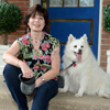 Michele Henderson posing with her American Eskimo dog, Minuk