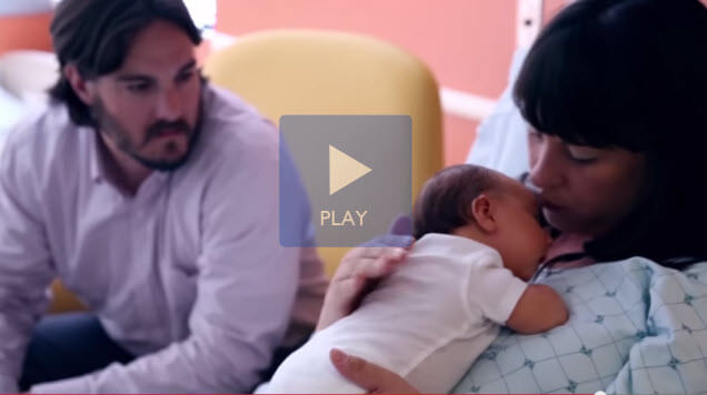 screen shot of mom dad and baby at birthing center