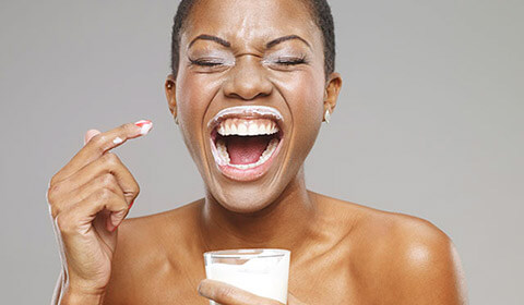 Woman drinking a glass of milk.