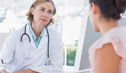 Woman speaking with her doctor.