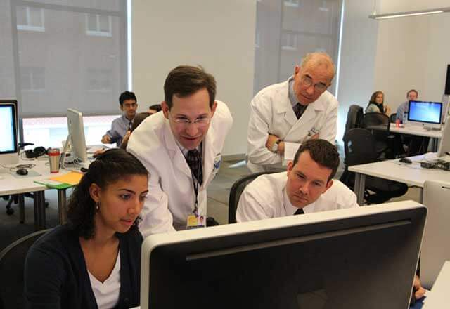 Faculty and students in the computer lab