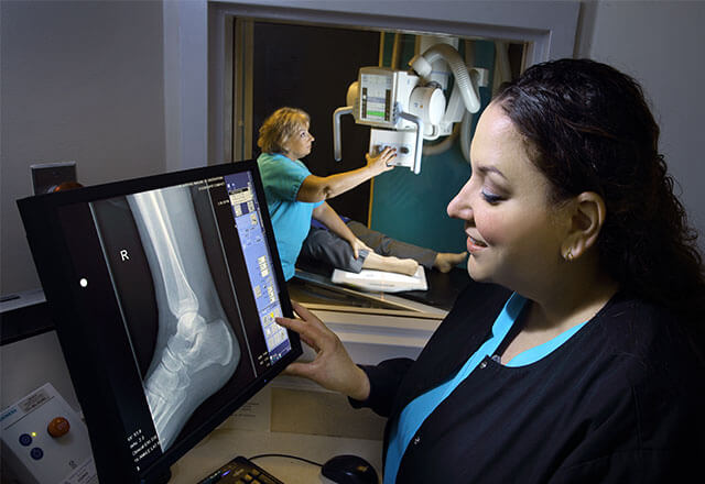 tech performing an ankle xray