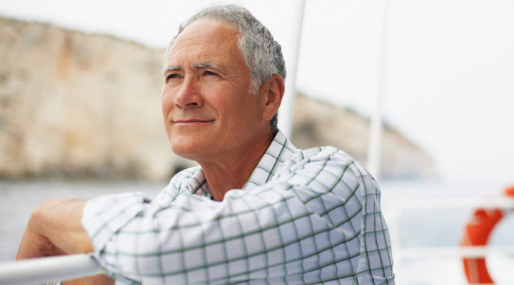 older man smiling on boat