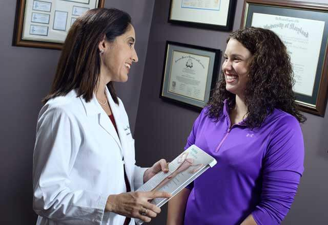 OBGYN speaking with patient