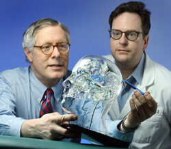 Gregory Bergey, left, and William Anderson now offer responsive neurostimulation therapy to control epileptic seizures—a treatment that was in clinical trials at Johns Hopkins and other sites, and was recently approved by the FDA. The inlay at left, a neu