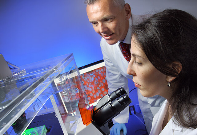 Dr. Roden and researcher in lab